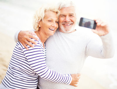 mid-life couple with camera